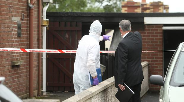 Police at the scene of the fatal fire in Carryduff started by Karen Hasson