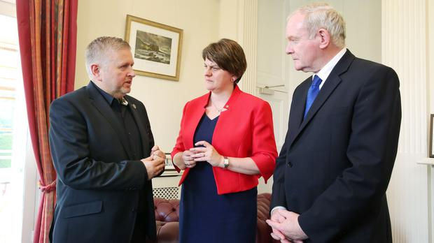 First Minister Arlene Foster and deputy First Minister Martin McGuinness (right) with Father Gary Donegan (left) at Stormont Castle (Press Eye)