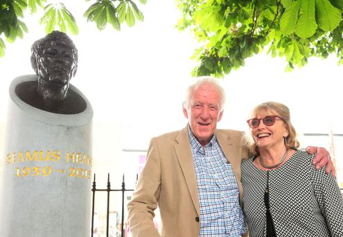 Marie Heaney and her brother-in-law Hugh Heaney, the brother of poet laureate Seamus Heaney, attend the unveiling of a bust in honour of her late husband in Sandymount Green, Dublin