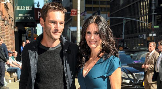 Johnny McDaid with Courteney Cox and (left) with Ed Sheeran
