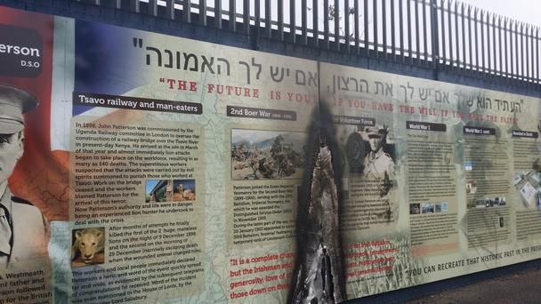 Scorch marks on the Jewish wall mural in Belfast