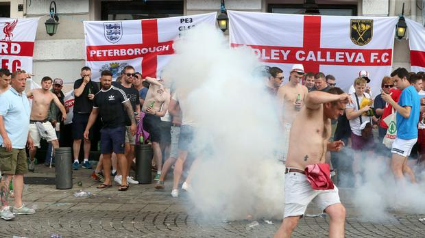 French police fire tear gas as they clash with English football fans at The Queen Victoria pub in Marseille