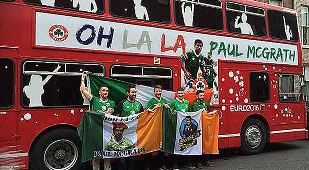 Andy Bennett from Malahide with Brian Cullen, Aidan McGuinness, Kevin Johnson and Eoin O'Donoghue, all from Skerries, stand outside their Irish bus (Handout/PA)