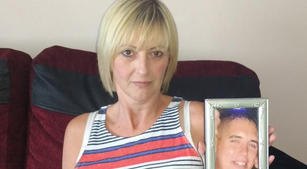 Jacqueline Burns with a picture of her son Jamie