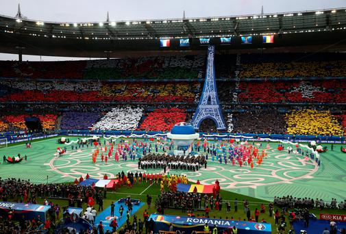 Let battle commence: The opening ceremony prior to the tournament opener between France and Romania at Stade de France in Paris last night