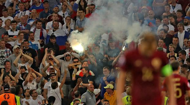Russia fans let off flares during the match in Marseille - Uefa opened disciplinary proceedings against the Russian Football Union for alleged crowd disturbances, racist behaviour and setting off fireworks