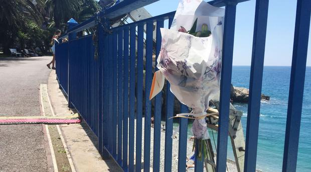 Flowers are left close to the scene where Darren Rodgers, from Ballymena, died after a fall in Nice