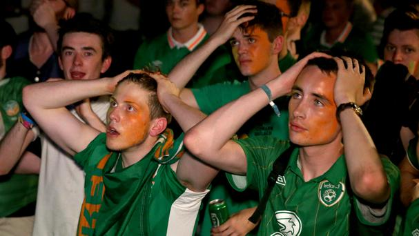 Republic of Ireland fans at The Hangar in Dublin city centre look dejected after Sweden equalize