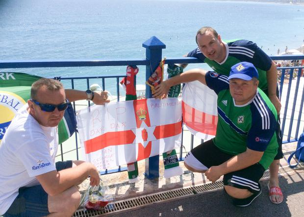 From left, friends Ian Thompson, George McFall and Darren McDonald who went to the match with their friend Darren Rodgers at the spot where he died in France