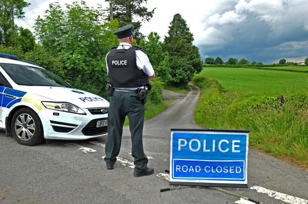 Police seal off a lane off Shillinghill Road near Markethill in south Armagh following the discovery of a man's body yesterday
