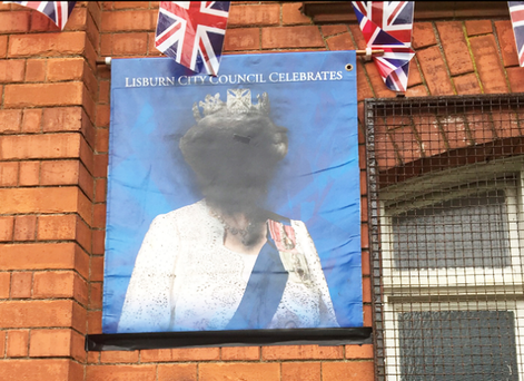 The damaged portrait of The Queen at the front of Derriaghy Orange Hall, near Lisburn