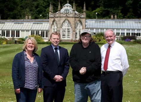 The Deputy First Minister, Martin McGuinness, and Junior Minister Alistair Ross meet Academy Award-winning filmmaker Michael Moore and Belfast Film Festival Director Michele Devlin at Stormont Castle.