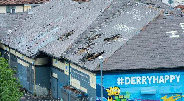 The derelict Meenan Park building with five holes in the roof