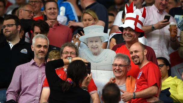 England supporters with a cut-out of The Queen during the Euro 2016 match in Lens