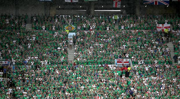 Northern Ireland fans show support for their team in the stands during the match in Lyon.