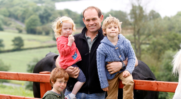 Farmer Simon Best with children Jack, Sam and Lucy on their farm in Poyntzpass
