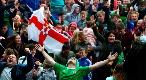 Northern Ireland fans who had gathered at the Titanic slipway enjoy the moment as their team produced heroics to beat Ukraine in Lyon