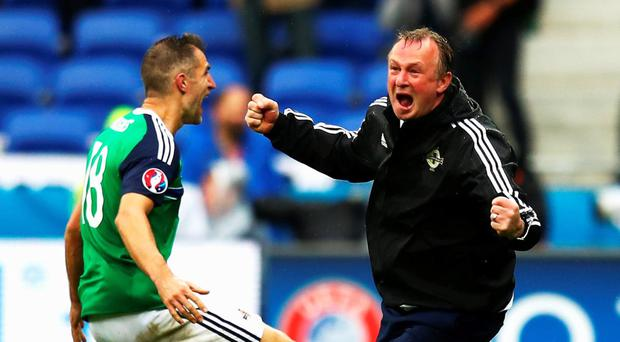 Michael O'Neill celebrates after the second goal scored by Niall McGinn
