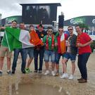 Irish fans in shorts and Belgians in trousers on a very wet day in Bordeaux, France, ahead of the Euro 2016 match between the two teams on Saturday