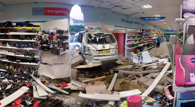 The scene of the car that crashed through the wall of Home Bargains in Omagh