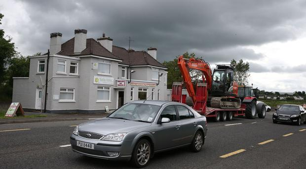 Traffic passes the building which once housed a customs post in the village of Bridgend