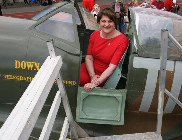First Minister Arlene Foster at the Armed Forces Day in the replica Down Spitfire funded by the Belfast Telegraph