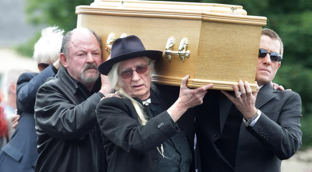 Dave Robinson (left) was one of the pallbearers