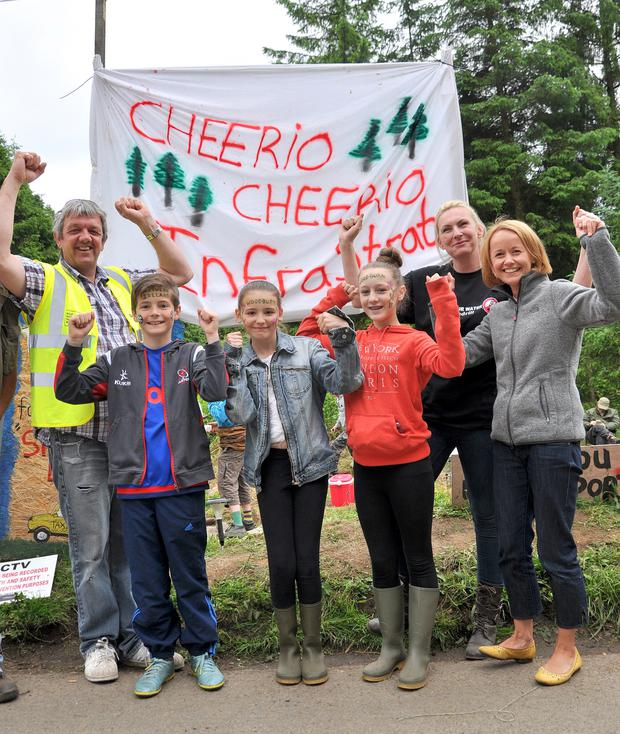 Stop The Drill protesters celebrate on Saturday night at Woodburn Forest near Carrickfergus