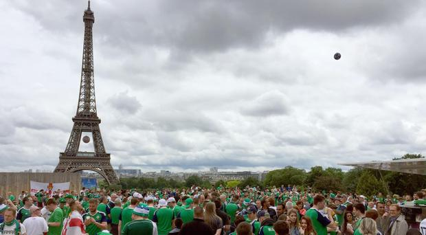 Northern Ireland fans play football at the Trocadero in Paris, France, ahead of their team's clash with Germany