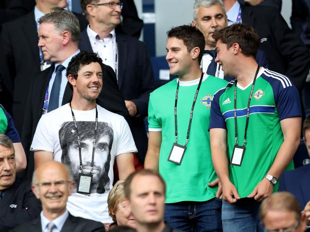 Rory McIlroy, wearing a George Best tee, watches the game with his friends in the Parc des Princes