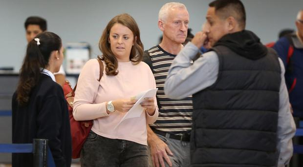 Melissa Reid at Lima Airport with her father Billy before boarding a flight back to the UK (AP)