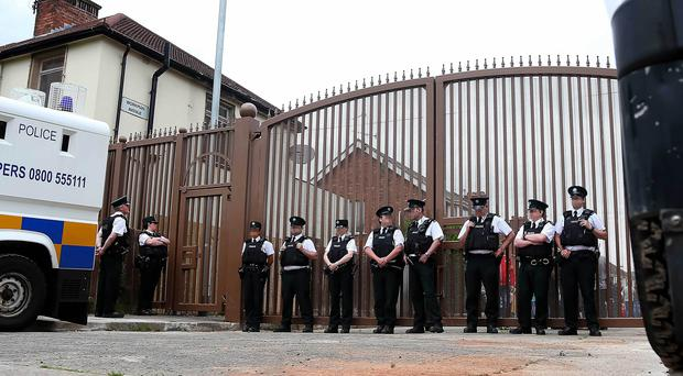 Police officers at Workmans Avenue junction of the Springfield road , a parades commission determination has ruled that the Whiterock Parade will not pass through the gates for the first time this coming weekend. Picture - Kevin Scott / Presseye
