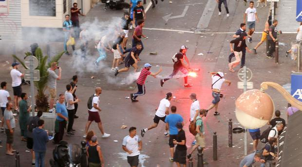 A fan running with a flare ahead of England's Euro 2016 game against Russia in Marseille