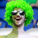 A Northern Ireland fan shows his support in the stands