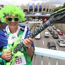 A Northern Ireland fan stands in front of the Parc des Princes stadium