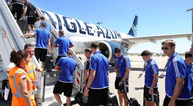 The Northern Ireland players board a plane to Paris from their base in Lyon ahead of today's game against Wales