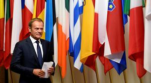 EU Council president Donald Tusk arrives for a statement on Brexit at the EU headquarters in Brussels yesterday