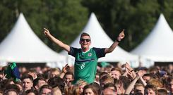 Northern Ireland supporters in the fanzone at Boucher Road playing fields in Belfast