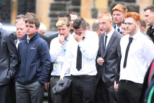 Friends and family attend the funeral in Ballymena of Darren Rodgers