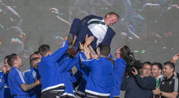 Manager Michael O'Neill celebrates with his players at the Titanic Fanzone, Belfast