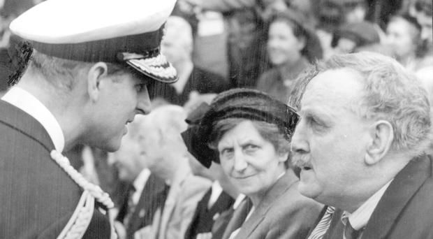 The Duke of Edinburgh talks to Robert Quigg during the royal couple's coronation visit to NI in 1953