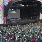 Northern Ireland's football team came home to a heroes' welcome last night as thousands turned out at the fanzone in Titanic Quarter