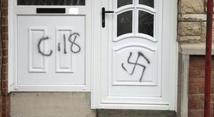 Racist graffiti daubed on the door of a house in the Orangefield area of Co Armagh (PSNI Armagh/PA)