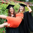 Celebrating their graduation from Ulster University were Kathryn Entwistle, from Carrickfergus, who received a degree in business with retail, and Clare Garvey, from Omagh, who was awarded a degree in business management