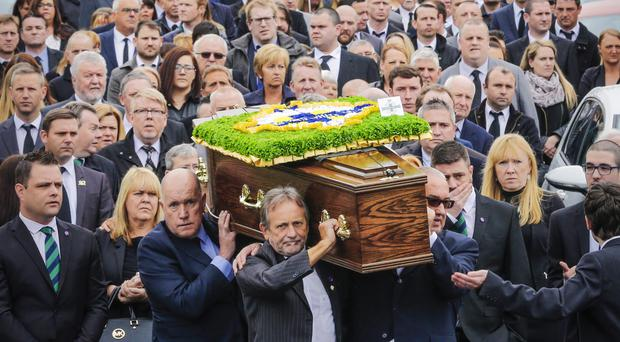 Mourners at the funeral of Robert Rainey yesterday
