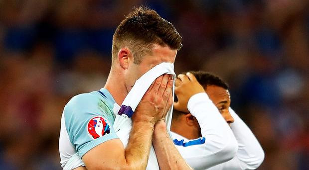 Gary Cahill shows his dejection after England's humiliating defeat by Iceland
