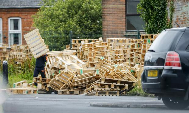 Fire wood being collected at the east Belfast site yesterday