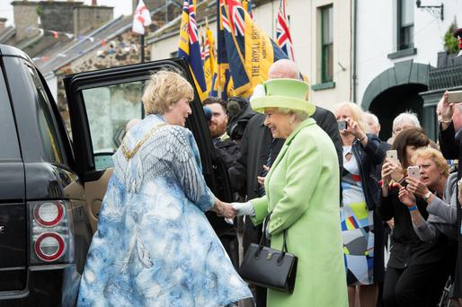 Mayor Maura Hickey (left) greets the Queen during a visit to Bushmills