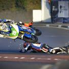 Dan Cooper and Ryan Farquhar crash at the North West 200
