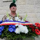 Colour Sergeant Trevor Ross takes delivery of wreaths from the Mayor of Thiepval, at the Ulster Memorial Tower in Thiepval, France, ahead of the Commemoration of the Centenary of the Battle of the Somme.